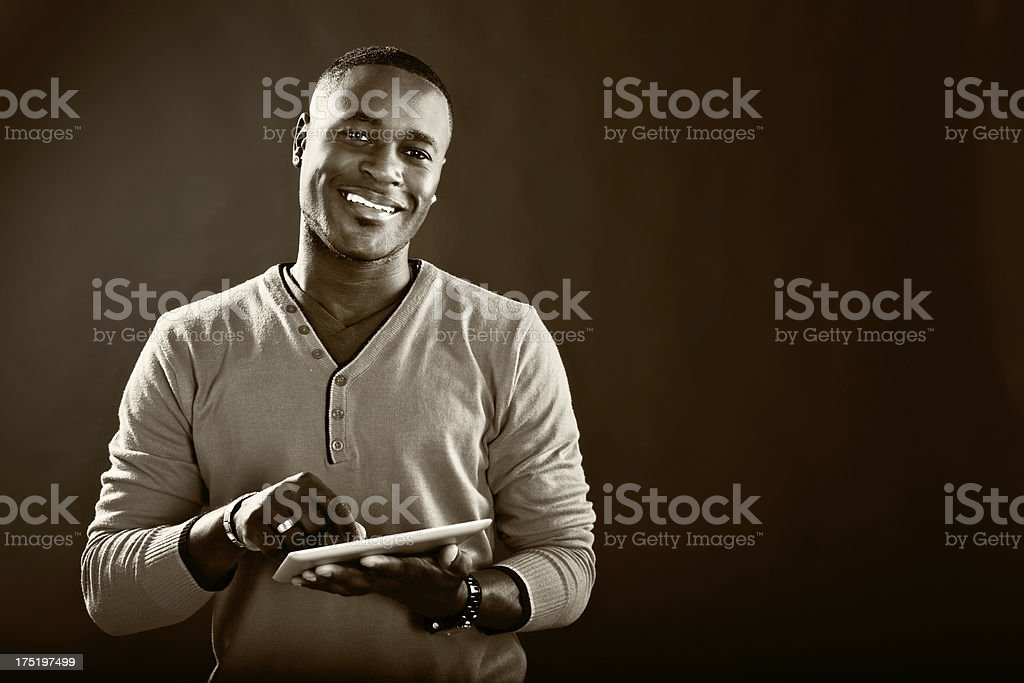 Black and white shot of happy man with digital tablet stock photo