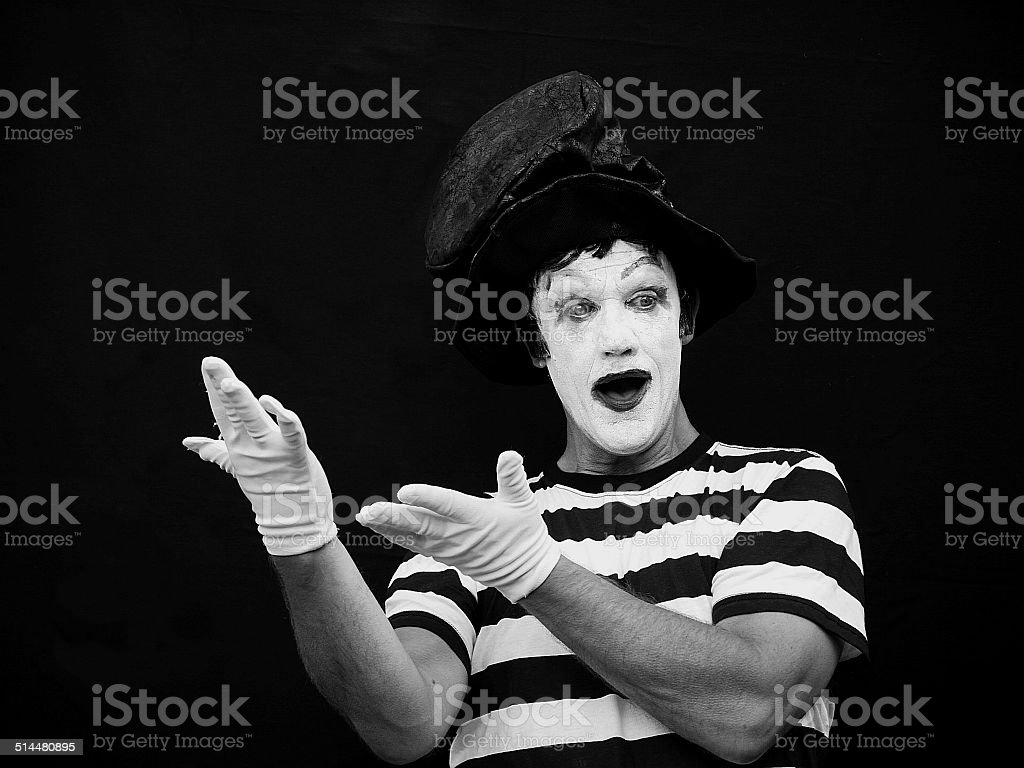 black and white shot of  mime artist both  hands outstretched stock photo