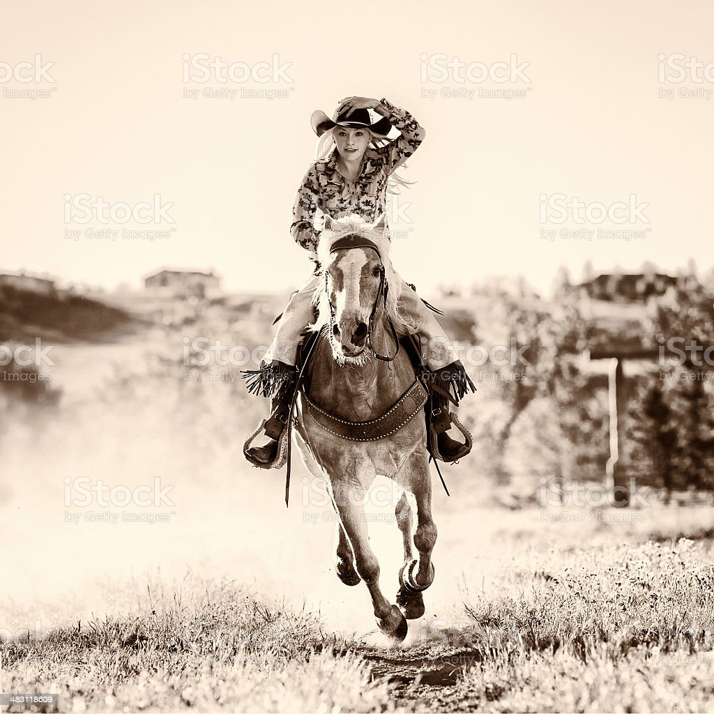Black and white shot of young woman on horseback stock photo