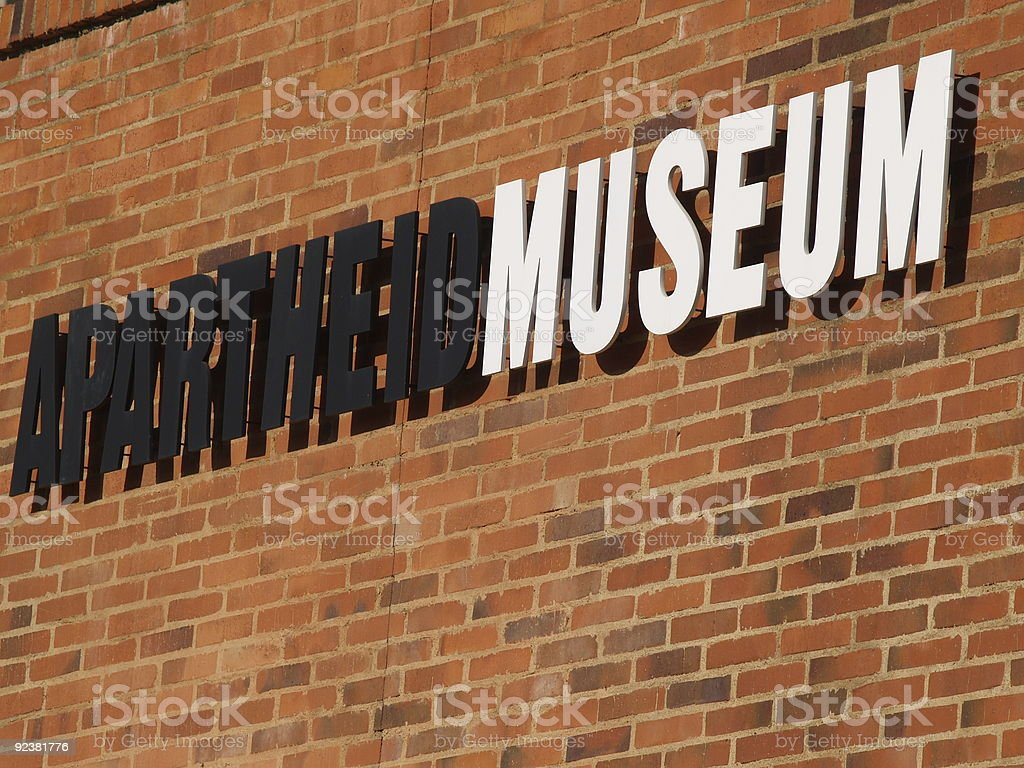 Black and white sign reading Apartheid Museum on brick  royalty-free stock photo