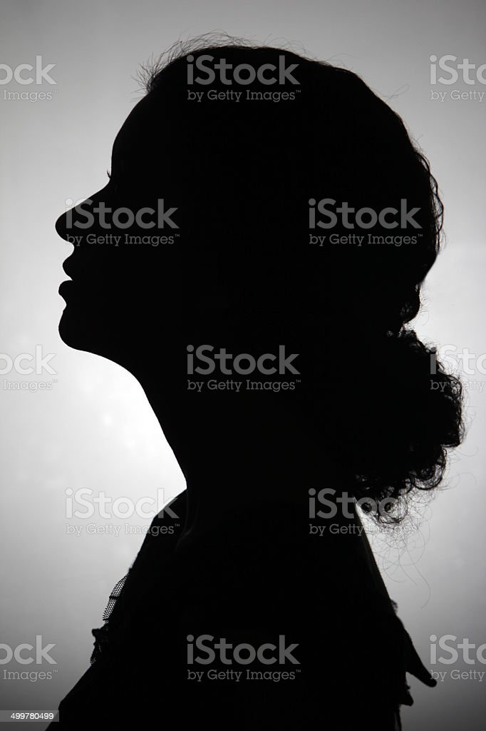 Black and white silhouette of a woman stock photo