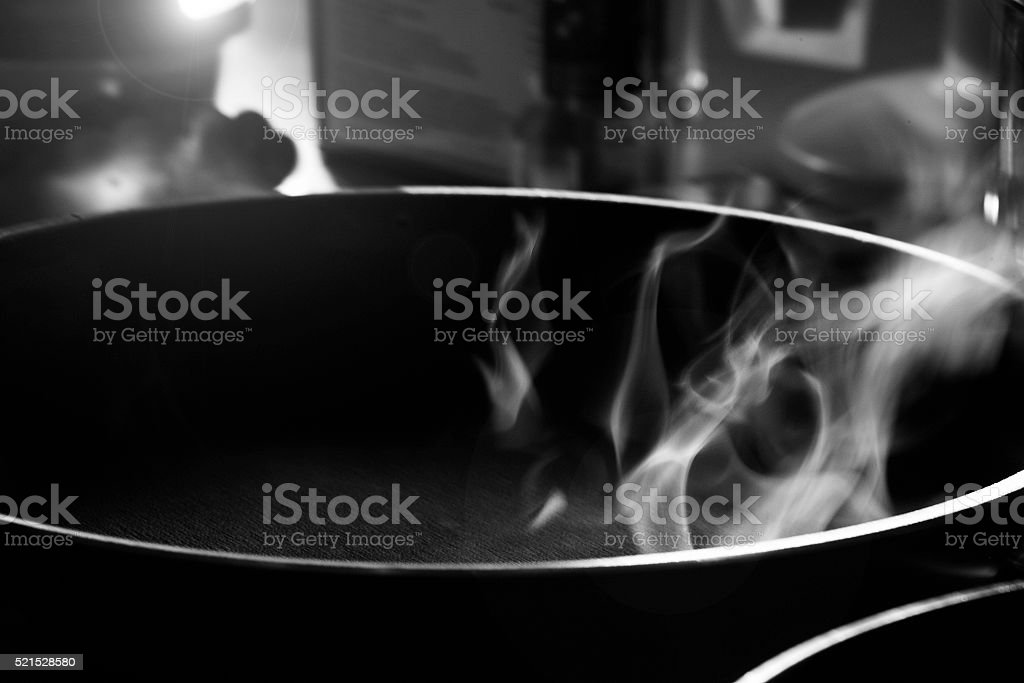 Black and white smoke from a skillet stock photo