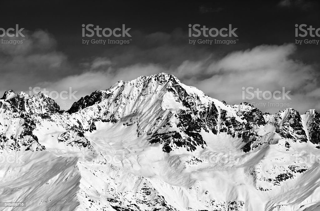 Black and white snowy mountains at sun day stock photo