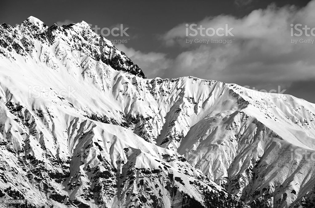 Black and white snowy sunlight mountains at nice day stock photo