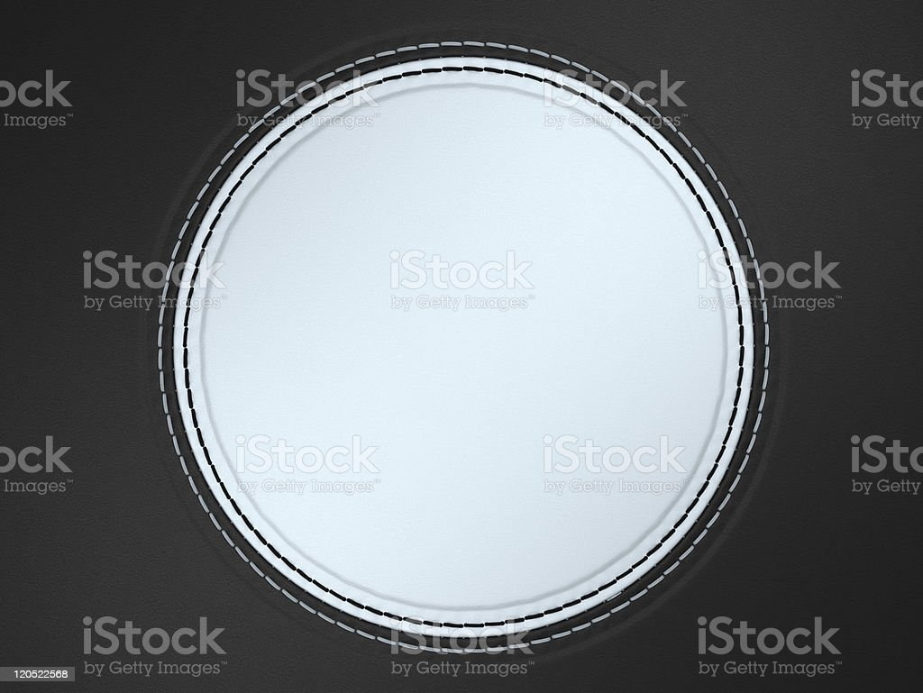 Black and white stitched circle shape on leather royalty-free stock photo