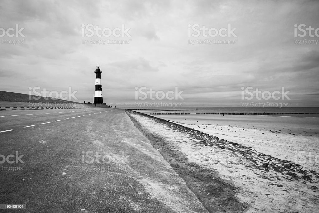 Black and white striped lighthouse, Breskens, The Netherlands stock photo