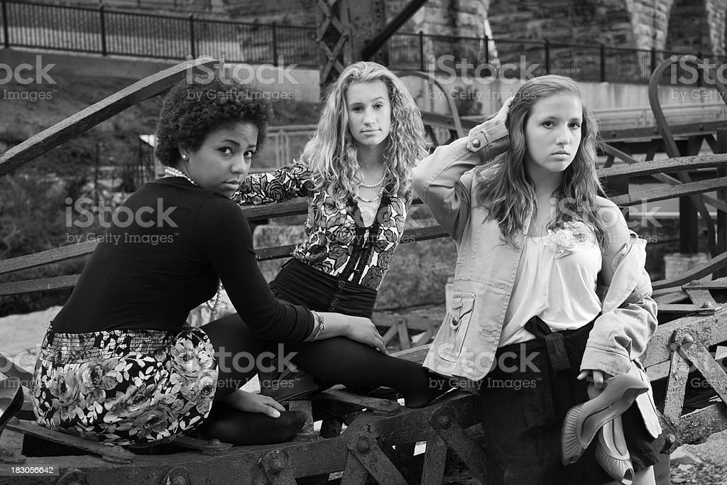 Black and White: Three Young Women, Teenage Girls, Industrial Ruin royalty-free stock photo