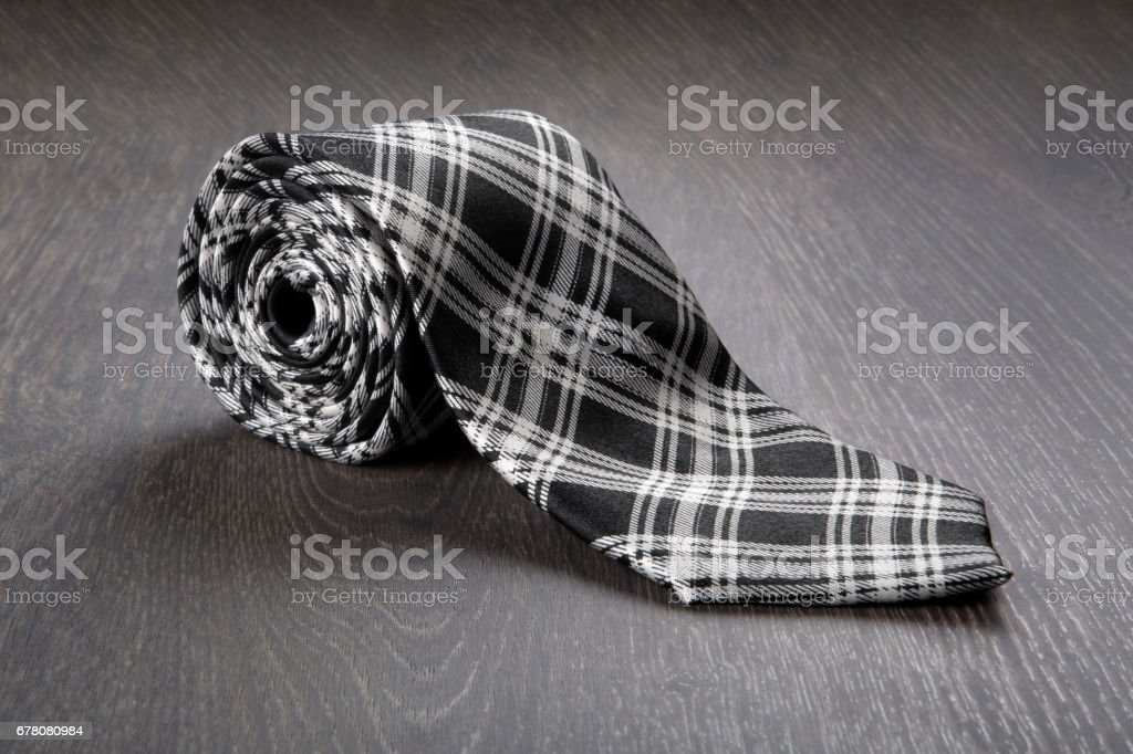 Black and white tie on wooden background stock photo