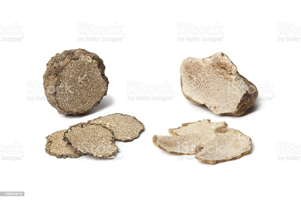 Black and white truffles on a white surface stock photo