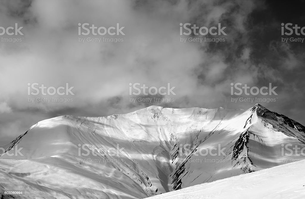 Black and white view on off-piste snowy slope stock photo