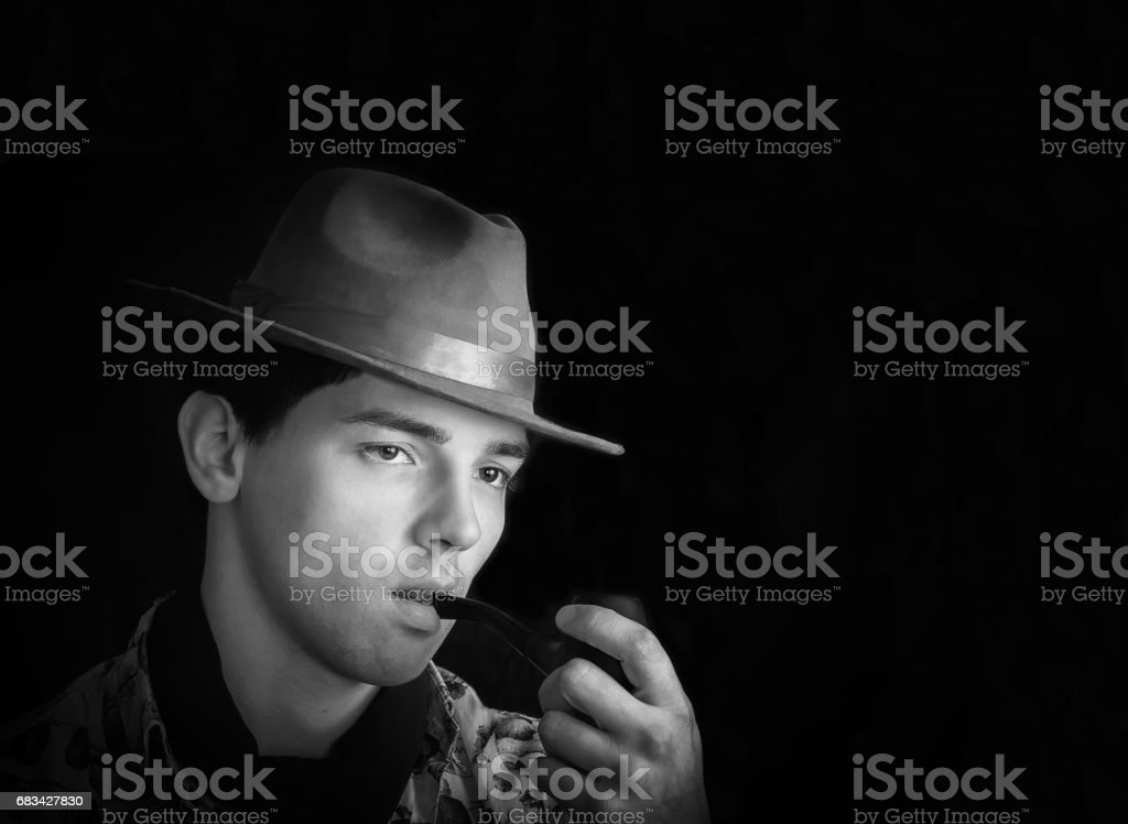 Black And White Vintage Portrait Of A Man With Pipe stock photo