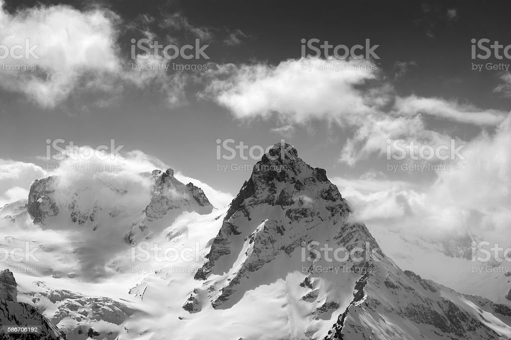 Black and white winter mountains in clouds stock photo