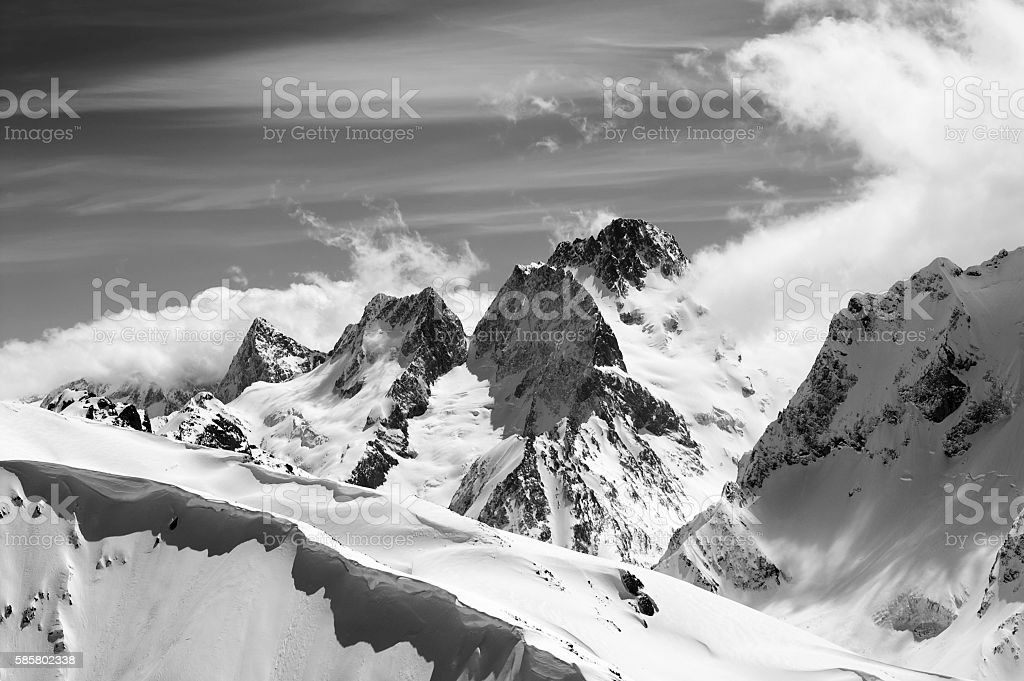 Black and white winter mountains with snow cornice stock photo