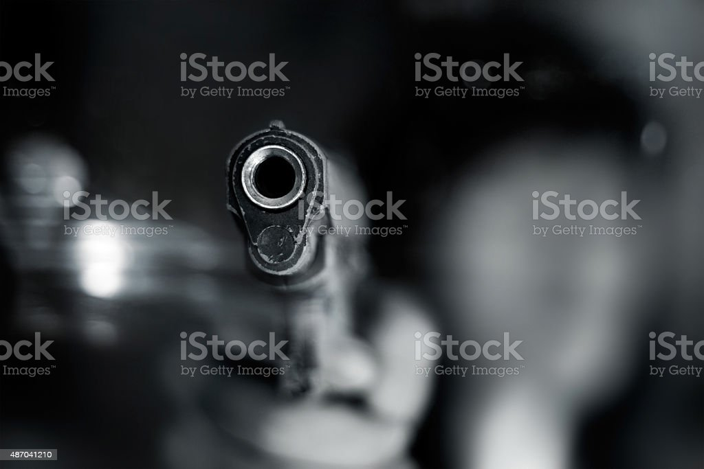 Black and white, woman pointing old gun to front stock photo