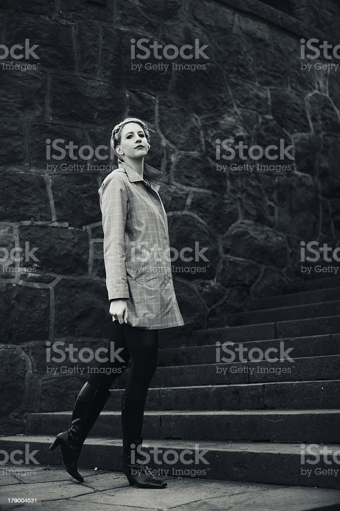 Black and White Woman Standing near Stone Wall royalty-free stock photo