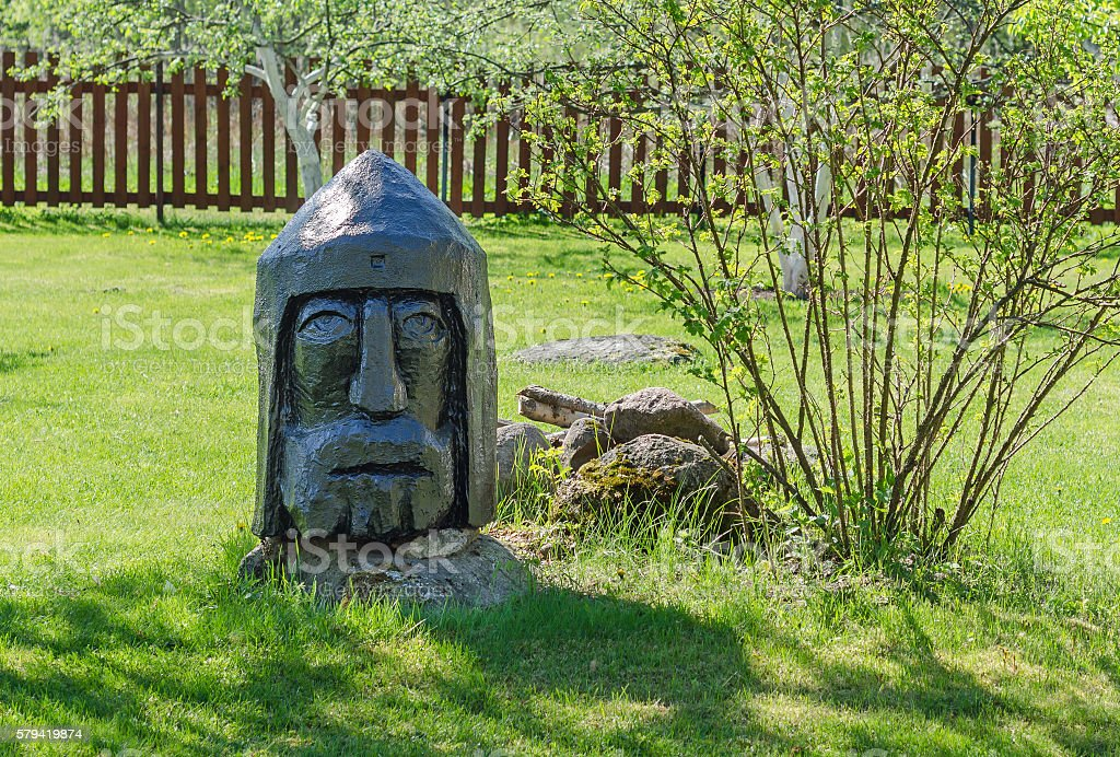 Black and wooden statue of the head stock photo