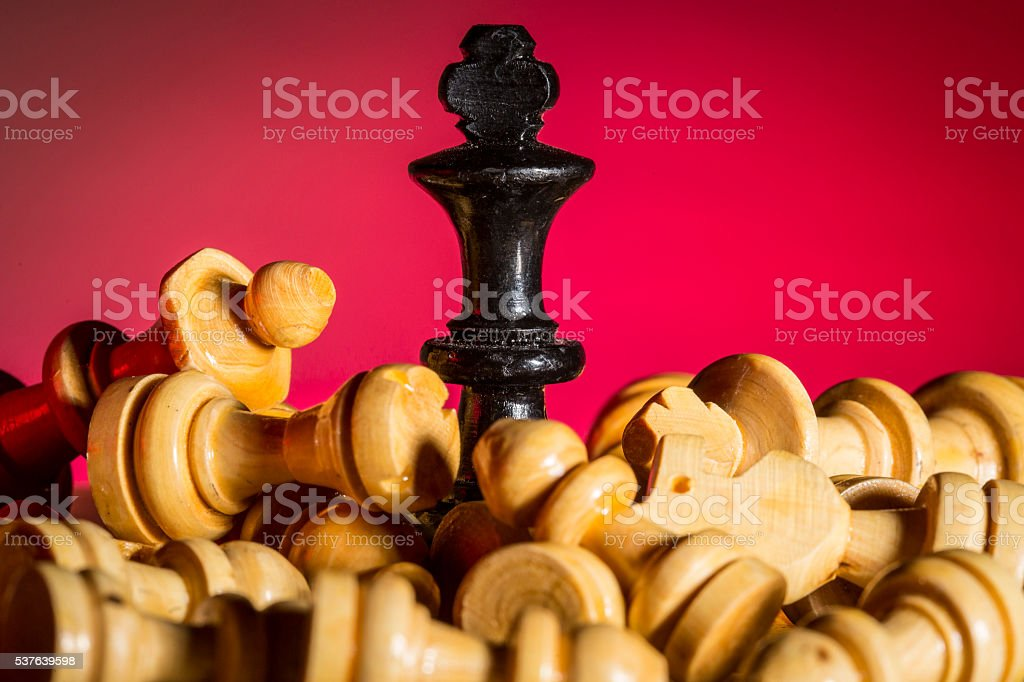 Black and yellow chess pieces stock photo