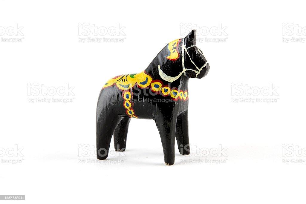 Black and yellow Dala horse stock photo