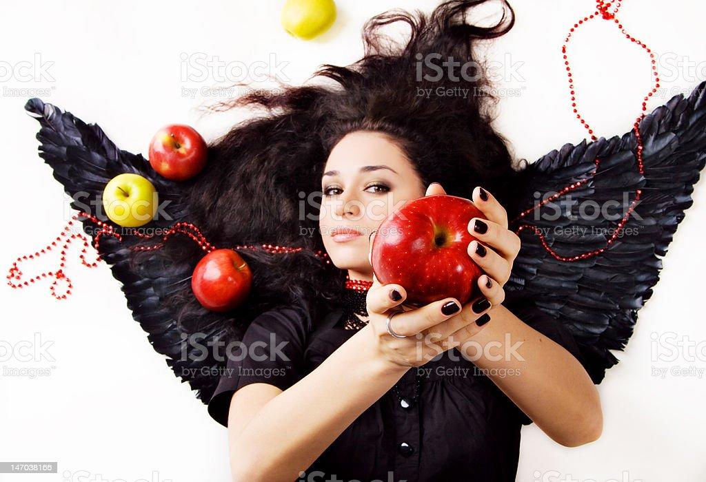 Black angel girl suggesting an apple royalty-free stock photo
