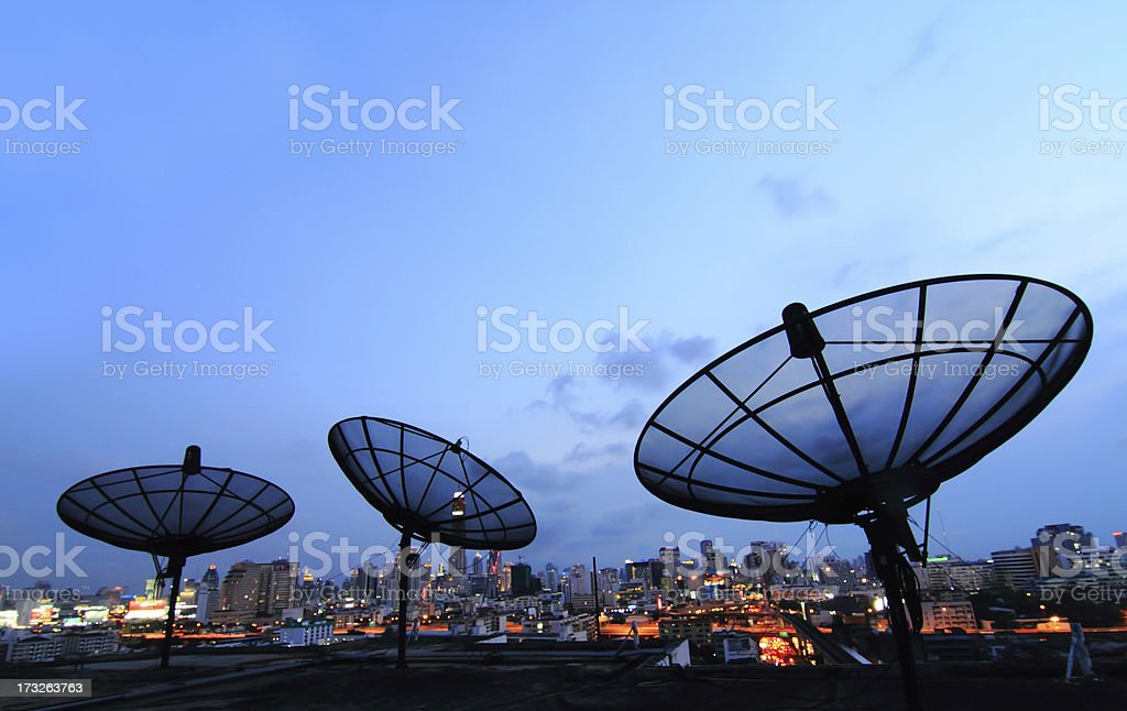 black antenna communication satellite dish over sunset sky in ci stock photo