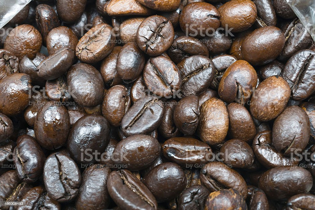Black arabic coffee beans in close up photo stock photo