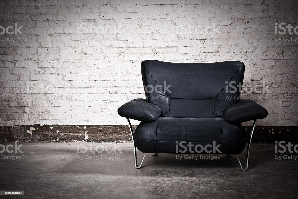 Black Armchair Nobody White Brick Wall Background royalty-free stock photo