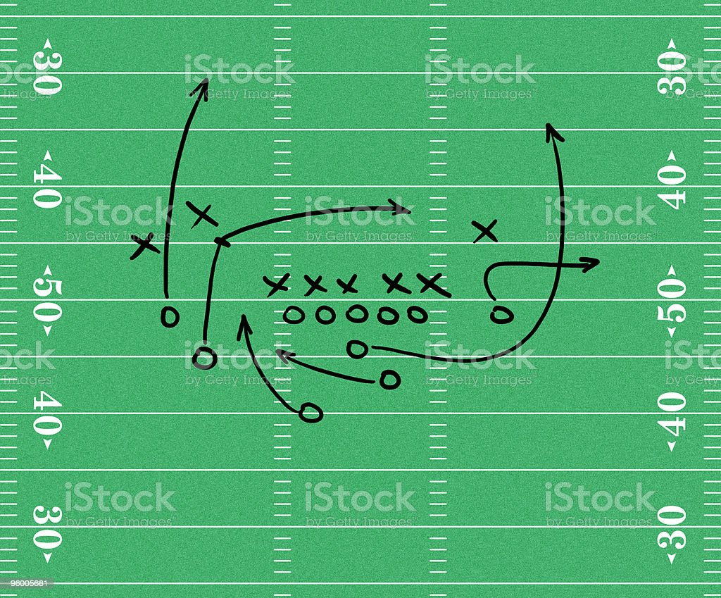 Black arrows drawn over a football pitch stock photo