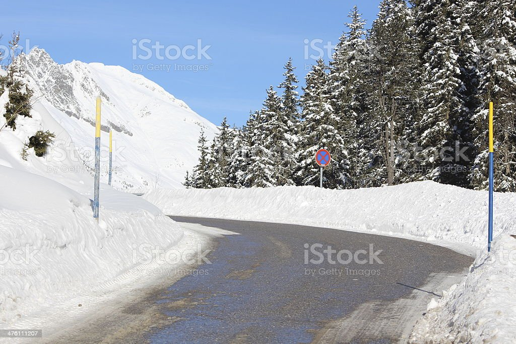 Black Aspahlt in a White Scenery, Zirmbach, Sellraintal, Tyrol, Austria royalty-free stock photo