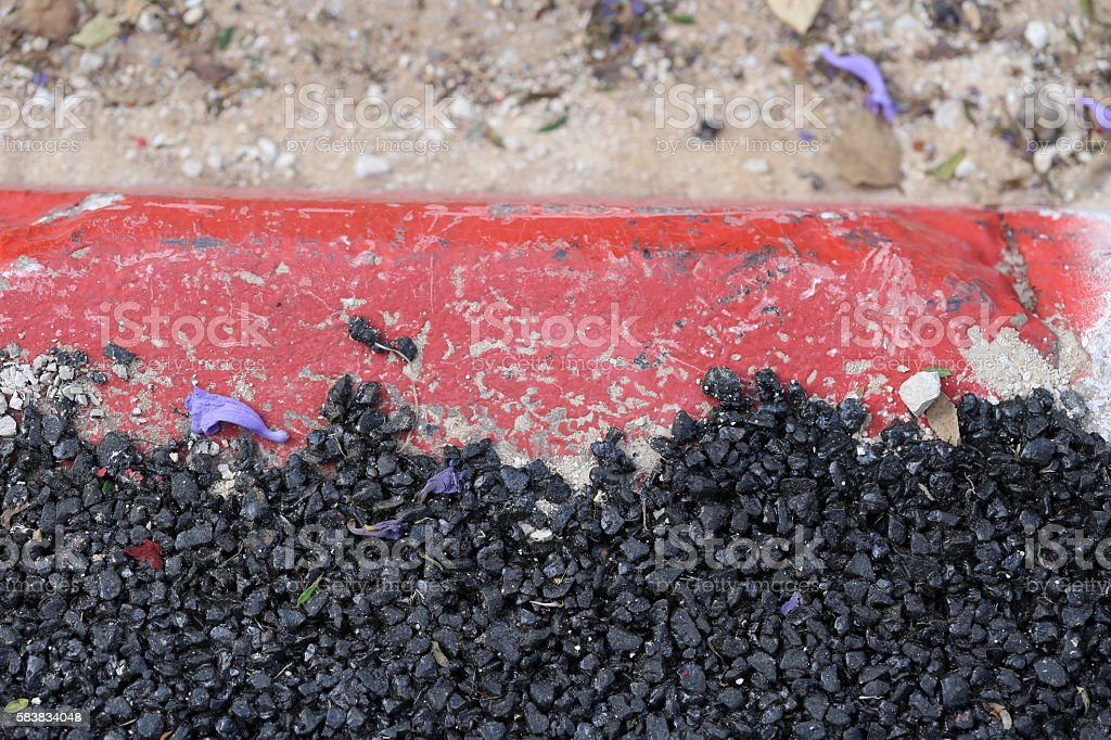 Black Asphalt Layer On Red Curbstone stock photo