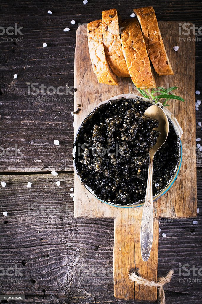 Black Astrakhan Russian salted sturgeon caviar in a can on stock photo