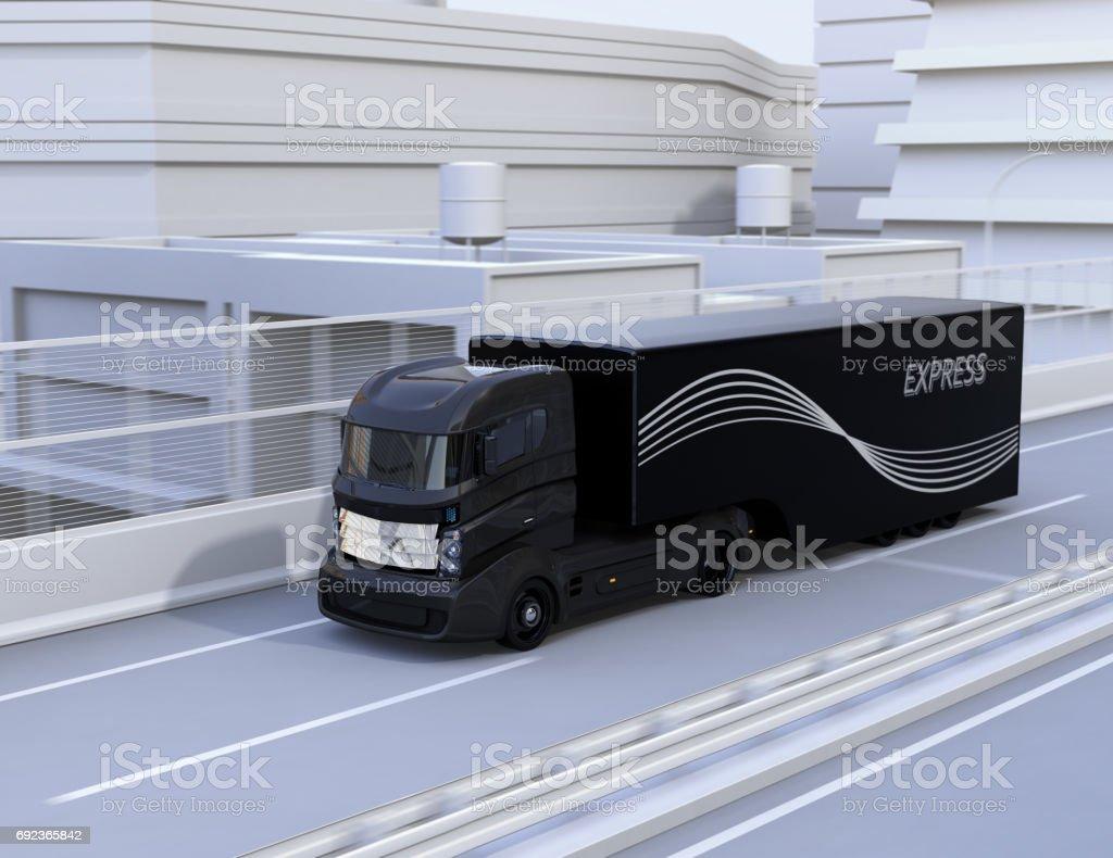 Black autonomous truck driving on highway stock photo