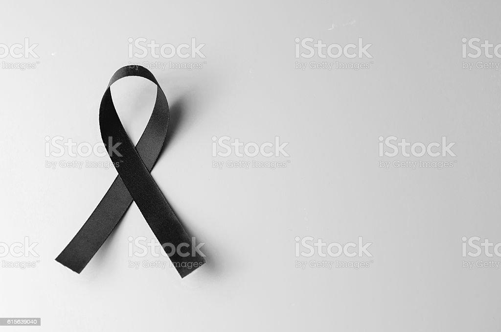 Black awareness ribbon on gray background. stock photo