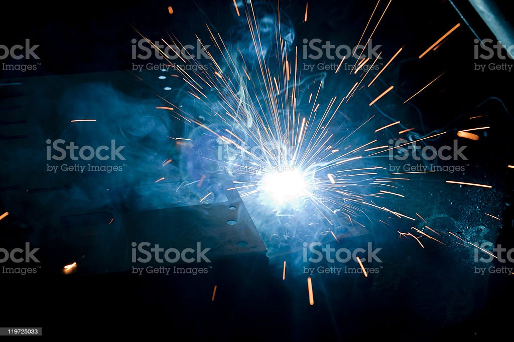 A black background and blue sparks from welding royalty-free stock photo
