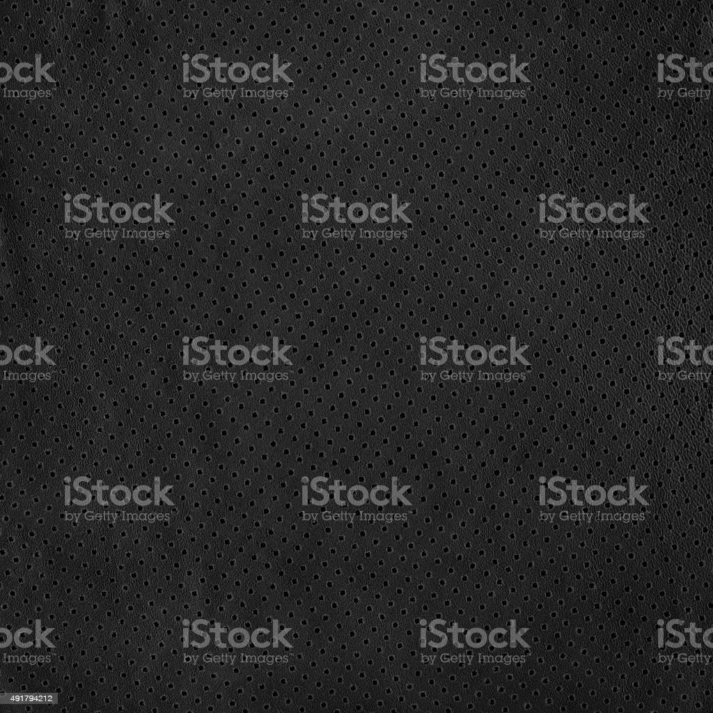 Black background from perforated leather texture stock photo