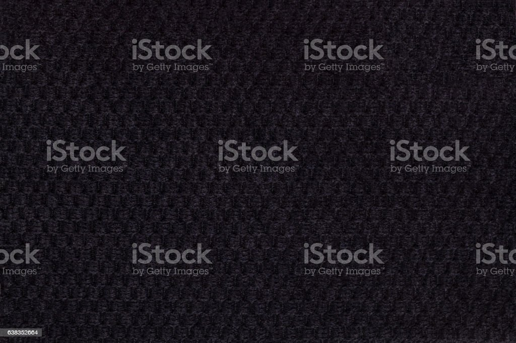 Black background from soft fleecy fabric closeup. Texture textiles stock photo