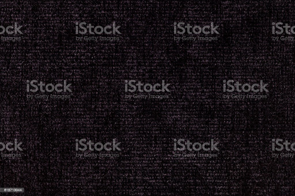 Black background from soft textile material. Fabric with natural texture stock photo