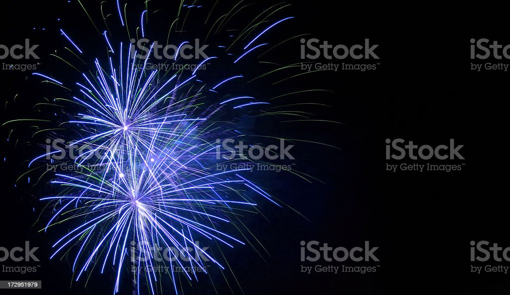 Black background with blue exploding fireworks royalty-free stock photo