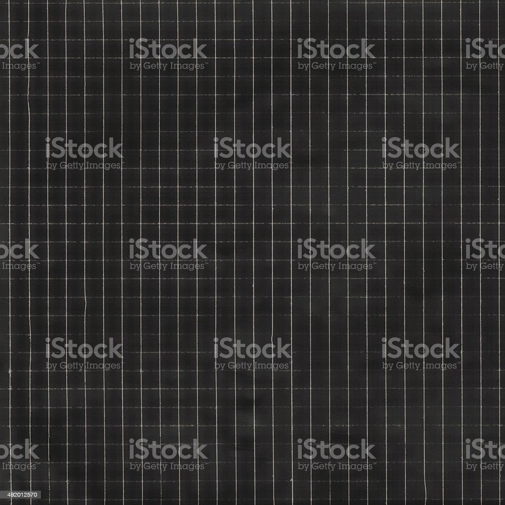 Black background with checkered paper texture stock photo