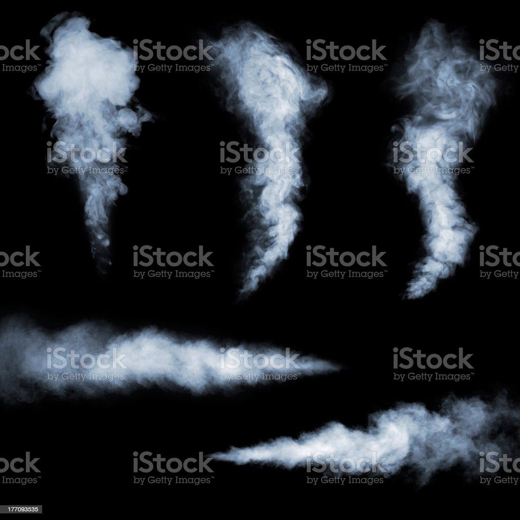 Black background with five clouds of white smoke stock photo