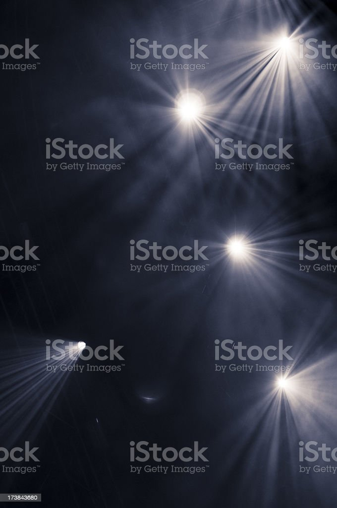 Black background with five scattered spotlights stock photo