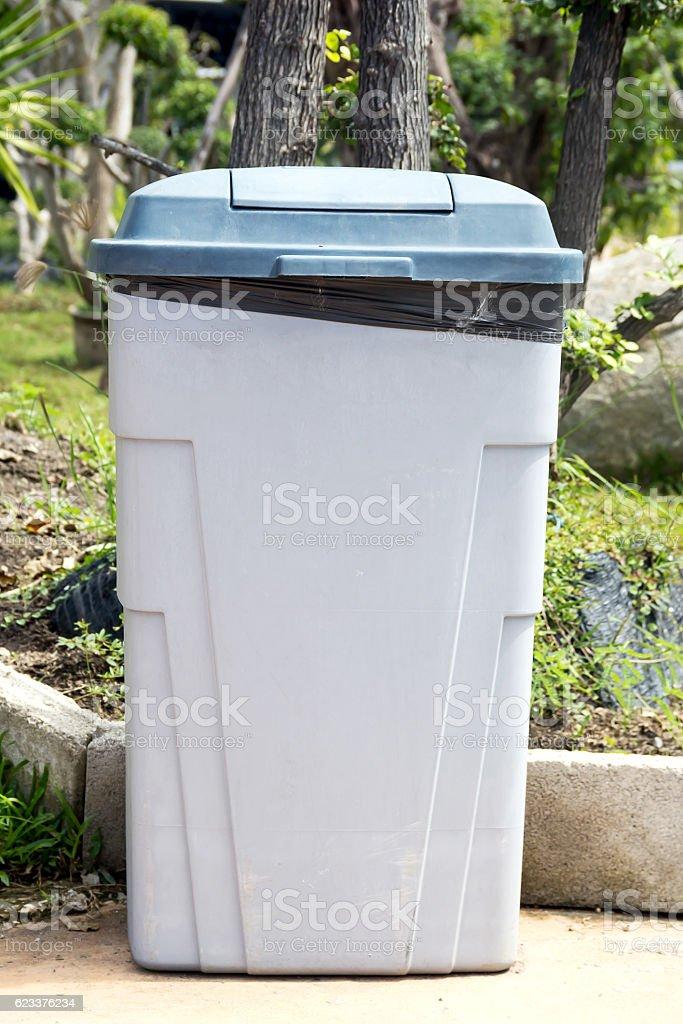 black bag plastic in white trashcan bin stock photo