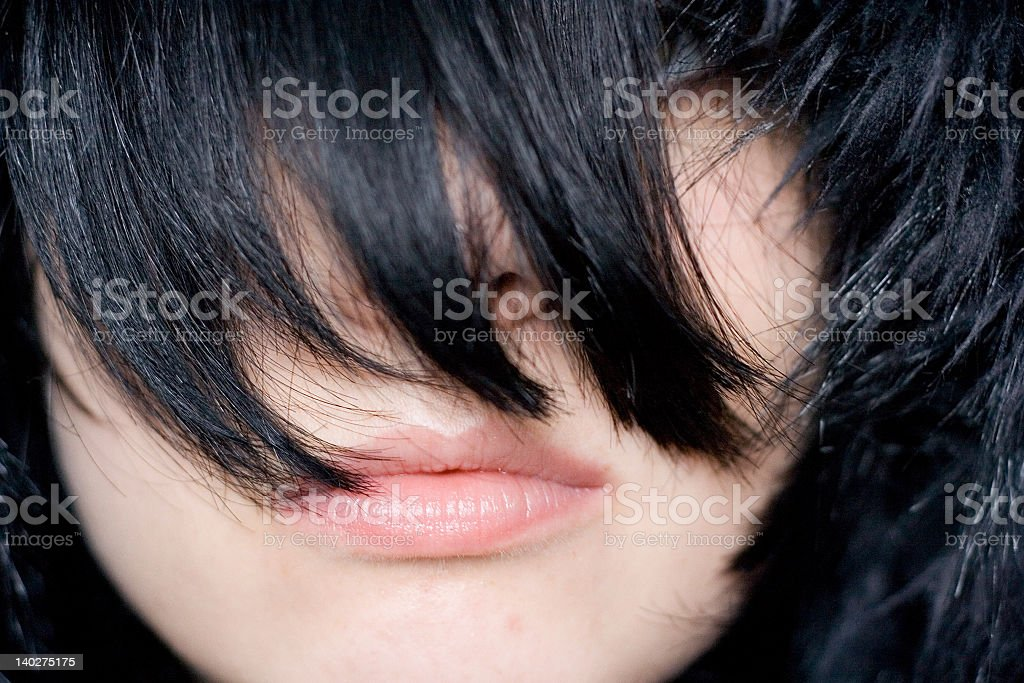 Black Bangs Covering Everything But Woman's Lips royalty-free stock photo