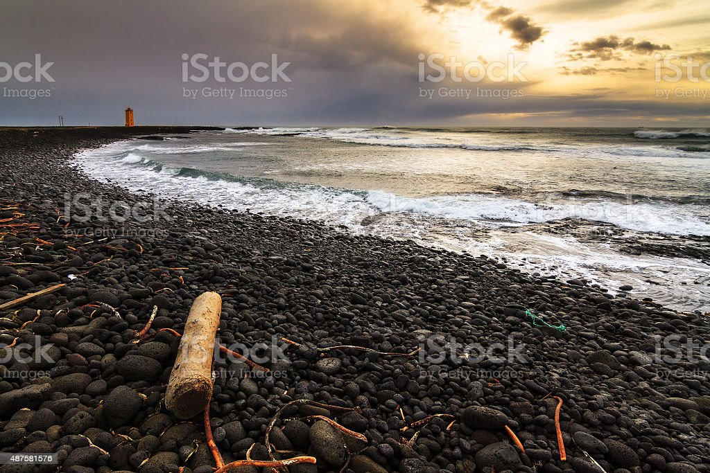 Black beach sunset Iceland stock photo