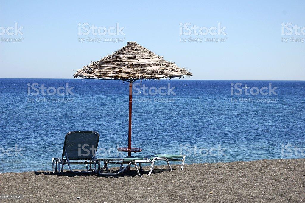 Black Beach with Umbrella royalty-free stock photo