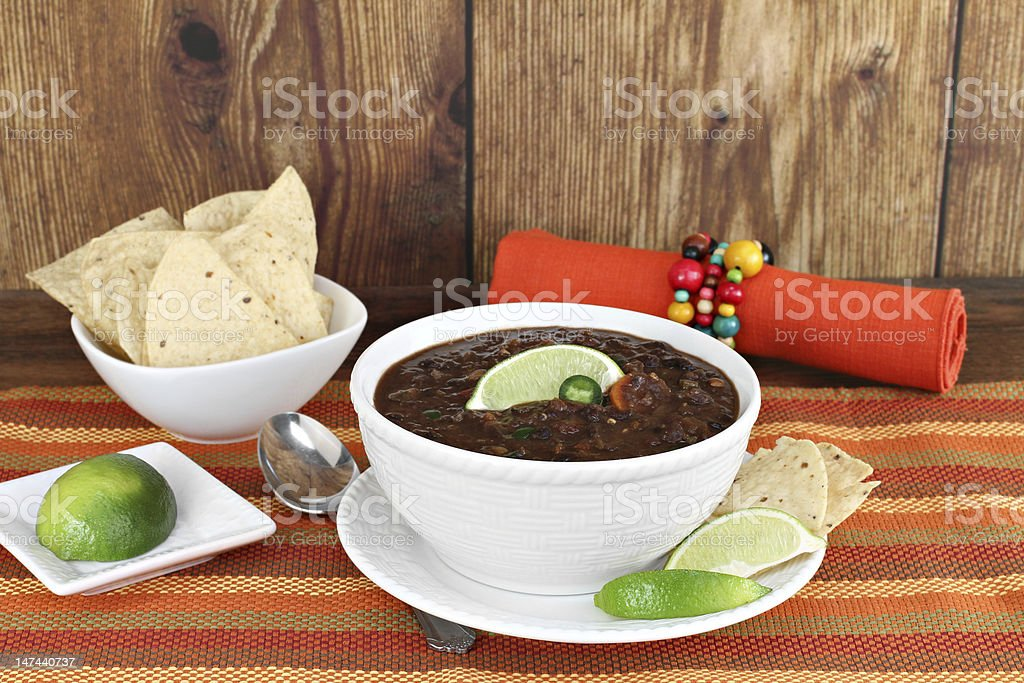 Black bean mexican soup with chips and lime. royalty-free stock photo