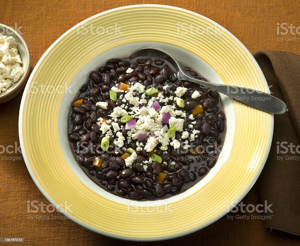 Black Bean soup sprinkled with Queso crumbled cheese stock photo