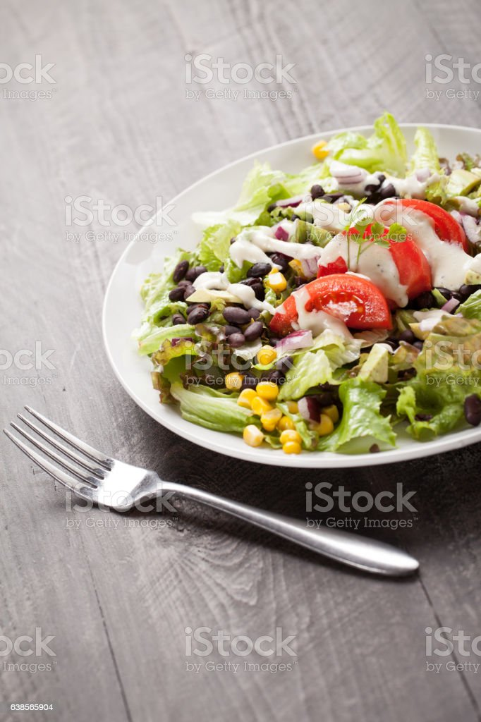 Black Bean Southwest Salad with fork stock photo