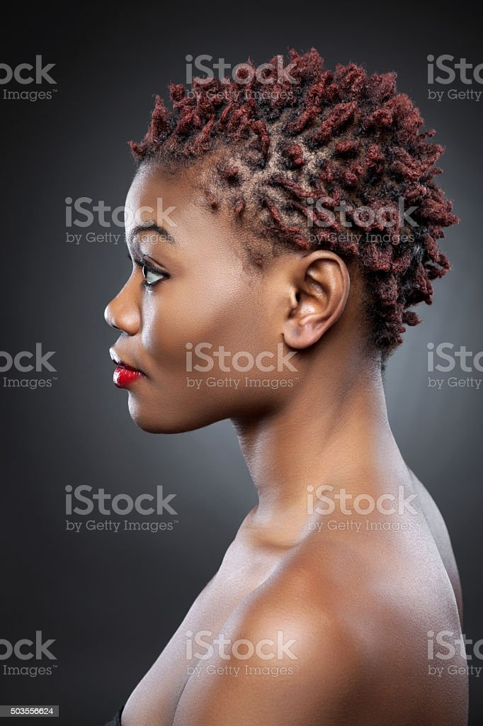 Black beauty with short spiky hair stock photo