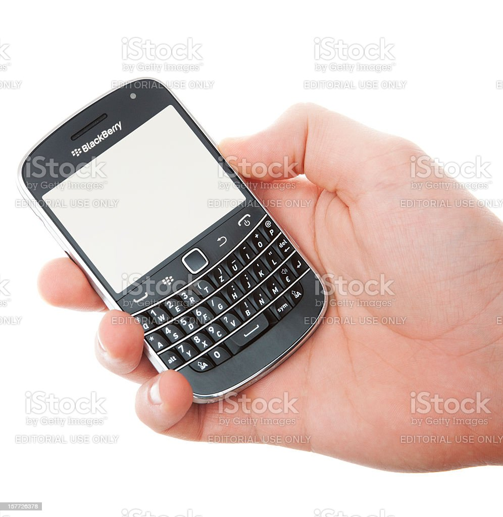 Black Berry smartphone in male hand royalty-free stock photo