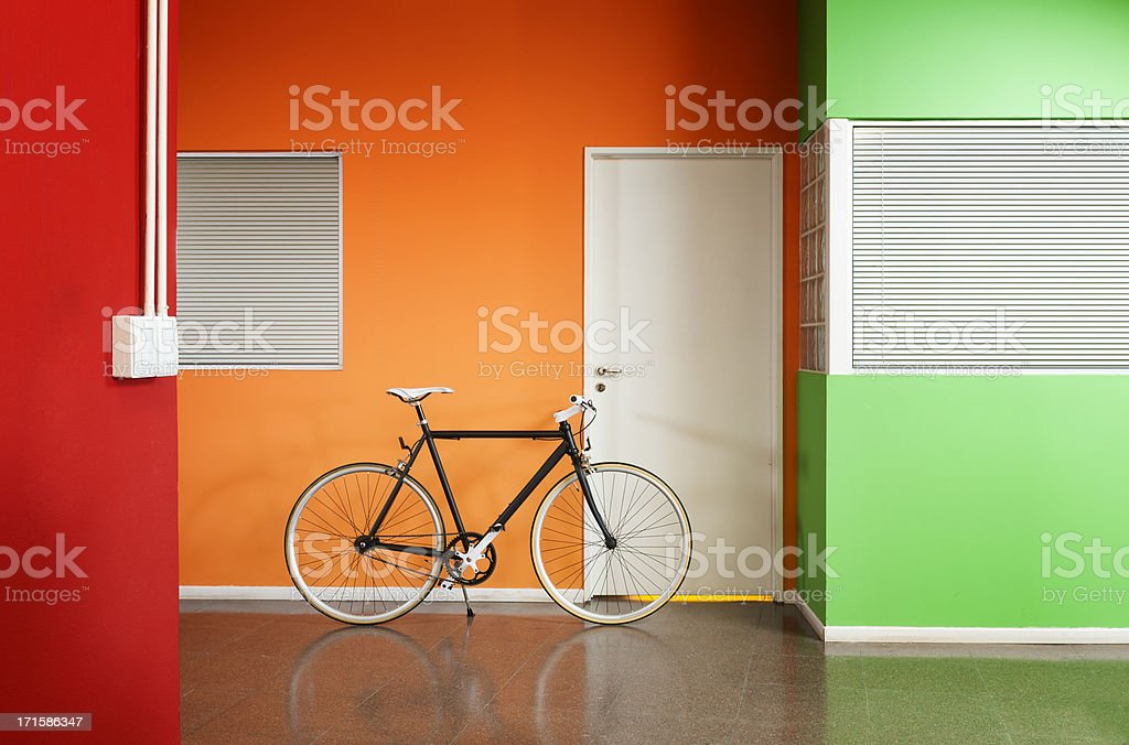 Black bicycle at the office. royalty-free stock photo